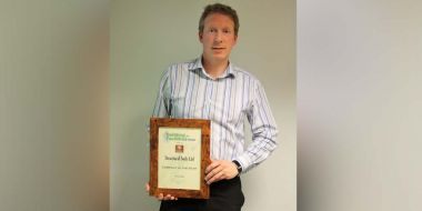 Principal engineer Rob Vollans receiving the Building and Facilities News Company of the Year Award